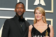 """(L-R) Mahershala Ali and Laura Dern, winner of Actress in a Supporting Role for """"Marriage Story"""", poses in the press room during the 92nd Annual Academy Awards at Hollywood and Highland on February 09, 2020 in Hollywood, California."""
