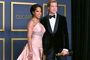 """Regina King (L) with Brad Pitt, winner of the Actor in a Supporting Role award for """"Once upon a Time...in Hollywood,"""" poses in the press room during the 92nd Annual Academy Awards at Hollywood and Highland on February 09, 2020 in Hollywood, California. (Photo by Amy Sussman/Getty Images)Brad Pitt, winner of the Actor in a Supporting Role award for """"Once upon a Time...in Hollywood,"""" poses in the press room during"""