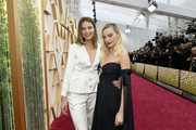 (L-R) Guest and Margot Robbie attend the 92nd Annual Academy Awards at Hollywood and Highland on February 09, 2020 in Hollywood, California.