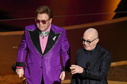 (L-R) Elton John and Bernie Taupin accept the Music - Original Song - award for 'I'm Gonna Love Me Again' from 'Rocketman' onstage during the 92nd Annual Academy Awards at Dolby Theatre on February 09, 2020 in Hollywood, California.