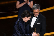 (L-R) Timothée Chalamet presents the Writing - Adapted Screenplay - award for 'Jojo Rabbit' to   Taika Waititi onstage during the 92nd Annual Academy Awards at Dolby Theatre on February 09, 2020 in Hollywood, California.