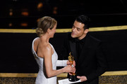 (L-R) Renée Zellweger accepts the Actress in a Leading Role award for 'Judy' from Rami Malek onstage during the 92nd Annual Academy Awards at Dolby Theatre on February 09, 2020 in Hollywood, California.