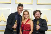 """Reese Witherspoon (center) poses with Will McCormack and Michael Govier, winners of Best Animated Short Film for """"If Anything Happens I Love You"""", in the press room during the Oscars on Sunday, April 25, 2021, at Union Station in Los Angeles."""