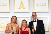 LOS ANGELES, CALIFORNIA – APRIL 25: (EDITORIAL USE ONLY) In this handout photo provided by A.M.P.A.S., (L-R) Pete Docter, Dana Murray and Reese Witherspoon winners of the Animated Feature Film award for 'Soul' poses in the press room during the 93rd Annual Academy Awards at Union Station on April 25, 2021 in Los Angeles, California.