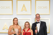 LOS ANGELES, CALIFORNIA – APRIL 25: (EDITORIAL USE ONLY) In this handout photo provided by A.M.P.A.S., (L-R) Dana Murray, Reese Witherspoon and Pete Doctor pose backstage with the Oscar® for Animated Feature Film during the 93rd Annual Academy Awards at Union Station on April 25, 2021 in Los Angeles, California.