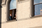 Jesse Tyler Ferguson (L) watches the 93rd Annual Macy's Thanksgiving Day Parade from The Dakota building on November 28, 2019 in New York City.