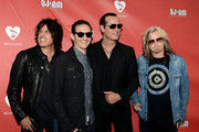 (L-R) Musicians Dean DeLeo, Chester Bennington, Robert DeLeo and Eric Kretz of Stone Temple Pilots at the 9th Annual MusiCares MAP Fund Benefit Concert at Club Nokia on May 30, 2013 in Los Angeles, California.