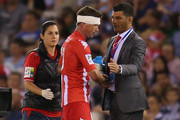 Harry Kewell of the Heart shakes the hand of Head Coach  John Aloisi as he is is substituted during the round one A-League match between the Melbourne Victory and the Melbourne Heart at Etihad Stadium on October 12, 2013 in Melbourne, Australia.