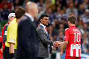 Head coach John Aloisi of Heart of Heart shakes the hand of player Harry Kewell (R) as he is substituted during the round 11 A-League match between Melbourne Heart and Melbourne Victory at AAMI Park on December 21, 2013 in Melbourne, Australia.