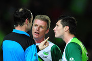 Ufuk Talay (c) and Chris Payne of the Fury talk to referee Gerard Parsons during the round 13 A-League match between the North Queensland Fury and the Central Coast Mariners at Dairy Farmers Stadium on November 5, 2010 in Townsville, Australia.