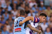 Brandon Wilson of the Glory is challenged by Luke Wilkshire of Sydney during the round 13 A-League match between Sydney FC and Perth Glory at Allianz Stadium on December 30, 2017 in Sydney, Australia.