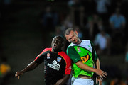 Scott Wilson of the Fury competes for  the ball with Lloyd Owusu of Adelaide United during the round eight A-League match between the North Queensland Fury and Adelaide United at Dairy Farmers Stadium on September 27, 2009 in Townsville, Australia.