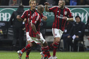 Nigel De Jong (C) of AC Milan celebrates with his team-mates Jeremy Menez (R) and Keisuke Honda (L) after scoring the opening goal during the Serie A match between AC Milan and ACF Fiorentina at Stadio Giuseppe Meazza on October 26, 2014 in Milan, Italy.