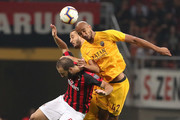 Gonzalo Higuain of AC Milan goes for a header with Steven Nzonzi of AS Roma during the serie A match between AC Milan and AS Roma at Stadio Giuseppe Meazza on August 31, 2018 in Milan, Italy.