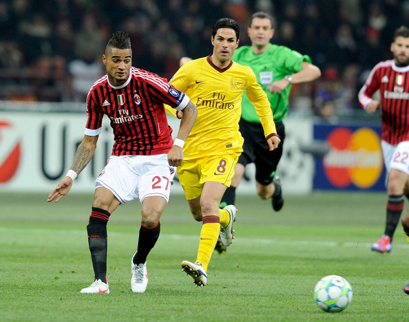 Kevin Prince Boateng of AC Milan and Mikel Arteta of Arsenal FC compete for the ball during the UEFA Champions League round of 16 first leg match between AC Milan and Arsenal FC at Stadio Giuseppe Meazza on February 15, 2012 in Milan, Italy.