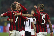 Jeremy Menez (L), Luca Antonelli (C) and Philippe Mexes (R) of AC Milan celebrate victory at the end of the Serie A match between AC Milan and Cagliari Calcio at Stadio Giuseppe Meazza on March 21, 2015 in Milan, Italy.