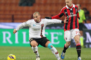 Ignazio Abate (R) of Milan competes for the ball with Alessio Camapgnacci of Reggina during the TIM Cup match between AC Milan and Reggina Calcio at San Siro Stadium on December 13, 2012 in Milan, Italy.