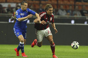 Alessio Cerci (R) of AC Milan is challenged by Djamel Mesbah (L) of UC Sampdoria during the Serie A match between AC Milan and UC Sampdoria  at Stadio Giuseppe Meazza on April 12, 2015 in Milan, Italy.