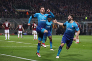 Aaron Ramsey of Arsenal celebrates with team-mate Sead Kolašinac after scoring during the UEFA Europa League Round of 16 match between AC Milan and Arsenal at the San Siro on March 8, 2018 in Milan, Italy.