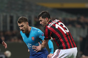 Aaron Ramsey of Arsenal FC competes for the ball with Alessio Romagnoli of AC Milan  during UEFA Europa League Round of 16 match between AC Milan and Arsenal at the San Siro on March 8, 2018 in Milan, Italy.