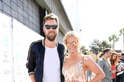 Charles Kelley and Cassie McConnell attend the ACM Lifting Lives TOPGOLF Tee-Off at Topgolf Las Vegas on April 14, 2018 in Las Vegas, Nevada.
