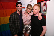 (L-R) Justin Mikita, Taylor Swift, and  Jesse Tyler Ferguson attend AEG and Stonewall Inn's pride celebration commemorating the 50th anniversary of the Stonewall Uprising. AEG has pledged its support to SIGBI's development of an LGBTQ+ anti-bias training standard. #EqualityForAll #BetterAsOne