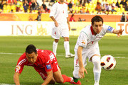 Mohammad Reza Khalatbari of Iran and Jong Tae Se of DPR Korea challenge each other for the ball during the AFC Asian Cup Group D match between DPR Korea and Iran at Qatar Sports Club Stadium on January 15, 2011 in Doha, Qatar.