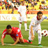 Jong Tae-Se Photos - Mohammad Reza Khalatbari of Iran and Jong Tae Se of DPR Korea challenge each other for the ball during the AFC Asian Cup Group D match between DPR Korea and Iran at Qatar Sports Club Stadium on January 15, 2011 in Doha, Qatar. - AFC Asian Cup - DPR Korea v Iran
