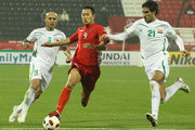 Ahmed Ibrahim of Iraq challenges Jong Tae Se of DPR during the AFC Asian Cup Group D match between Iraq and DPR Korea at Al-Rayyan on January 19, 2011 in Doha, Qatar.