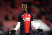 Wilfried Zaha of Crystal Palace reacts as he warms up ahead of  the Premier League match between AFC Bournemouth and Crystal Palace at Vitality Stadium on October 1, 2018 in Bournemouth, United Kingdom.