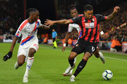 Aaron Wan-Bissaka of Crystal Palace looks on as Joshua King of AFC Bournemouth controls the ball as Wilfried Zaha of Crystal Palace looks on during the Premier League match between AFC Bournemouth and Crystal Palace at Vitality Stadium on October 1, 2018 in Bournemouth, United Kingdom.