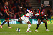 Wilfried Zaha of Crystal Palace battles for possession with Jefferson Lerma of AFC Bournemouth during the Premier League match between AFC Bournemouth and Crystal Palace at Vitality Stadium on October 1, 2018 in Bournemouth, United Kingdom.