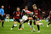 Wilfried Zaha of Crystal Palace battles for possession with David Brooks of AFC Bournemouth during the Premier League match between AFC Bournemouth and Crystal Palace at Vitality Stadium on October 1, 2018 in Bournemouth, United Kingdom.