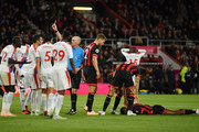 Jefferson Lerma of AFC Bournemouth lays on the floor after being fouled by Mamadou Sakho of Crystal Palace (left) as match Referee Mike Dean awards Bournemouth a penalty during the Premier League match between AFC Bournemouth and Crystal Palace at Vitality Stadium on October 1, 2018 in Bournemouth, United Kingdom.