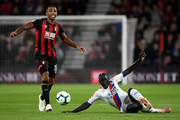 Callum Wilson of AFC Bournemouth battles for possession with Mamadou Sakho of Crystal Palace during the Premier League match between AFC Bournemouth and Crystal Palace at Vitality Stadium on October 1, 2018 in Bournemouth, United Kingdom.