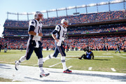 Jimmy Garoppolo #10 and Tom Brady #12 of the New England Patriots run on to the field prior to the AFC Championship game against the Denver Broncos at Sports Authority Field at Mile High on January 24, 2016 in Denver, Colorado.