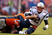 Tom Brady #12 of the New England Patriots is sacked by  Von Miller #58 of the Denver Broncos in the second quarter in the AFC Championship game at Sports Authority Field at Mile High on January 24, 2016 in Denver, Colorado.