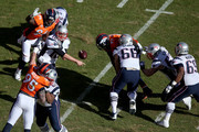 Tom Brady #12 of the New England Patriots passes in the first quarter in the AFC Championship game at Sports Authority Field at Mile High on January 24, 2016 in Denver, Colorado.