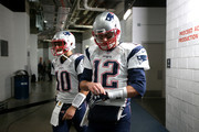 Jimmy Garoppolo #10 and Tom Brady #12 of the New England Patriots take the field prior to the AFC Championship game against the Denver Broncos at Sports Authority Field at Mile High on January 24, 2016 in Denver, Colorado.