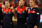 (L-R) Jack Viney of the Demons, Nathan Jones of the Demons and Simon Goodwin, Senior Coach of the Demons look on during the 2018 AFL First Elimination Final match between the Melbourne Demons and the Geelong Cats at the Melbourne Cricket Ground on September 07, 2018 in Melbourne, Australia.