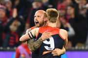 Nathan Jones of the Demons is congratulated by Charlie Spargo after kicking a goalduring the AFL First Elimination Final match between the Melbourne Demons and the Geelong Cats at the Melbourne Cricket Ground on September 7, 2018 in Melbourne, Australia.
