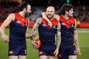L-R Jordan Lewis, Nathan Jones and Angus Brayshaw of the Demons celebrate after winning the clubs first final in 12 years during the 2018 AFL First Elimination Final match between the Melbourne Demons and the Geelong Cats at the Melbourne Cricket Ground on September 07, 2018 in Melbourne, Australia.