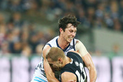 Jack Henry of the Cats tackles Harry McKay of the Blues during the round 10 AFL match between the Geelong Cats and the Carlton Blues at GMHBA Stadium on May 26, 2018 in Geelong, Australia.