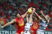 (L-R) Steven May of the Suns, Jack Henry of the Cats, Alex Sexton of the Suns and Tom Stewart of the Cats compete for the ball  during the 2018 AFL round 11 match between the Gold Coast Suns and the Geelong Cats at Metricon Stadium on June 02, 2018 on the Gold Coast, Australia.