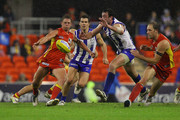 Daniel Harris of the Suns kicks the ball during the round 12 AFL match between the Gold Coast Suns and the North Melbourne Kangaroos at Metricon Stadium on June 11, 2011 in Gold Coast, Australia.