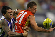 Daniel Harris of the Suns is tackled by Aaron Edwards of the Kangaroos during the round 12 AFL match between the Gold Coast Suns and the North Melbourne Kangaroos at Metricon Stadium on June 11, 2011 in Gold Coast, Australia.