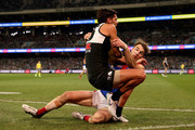 Riley Bonner of the Power is tackled by Tim Smith of the Demons during the 2018 AFL round 14 match between the Port Adelaide Power and the Melbourne Demons at Adelaide Oval on June 22, 2018 in Adelaide, Australia.
