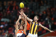 Ryan Griffen of the Giants is challenged by Ricky Henderson of the Hawks during the round 15 AFL match between the Greater Western Sydney Giants and the Hawthorn Hawks at Spotless Stadium on June 30, 2018 in Sydney, Australia.