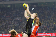 Jack Riewoldt of the Tigers marks the ball over Nick Smith (left) and Dane Rampe of the Swans and Jason Castagna of the Tigers during the 2018 AFL round 15 match between the Richmond Tigers and the Sydney Swans at Etihad Stadium on June 28, 2018 in Melbourne, Australia.