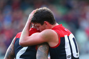Nathan Jones ands Angus Brayshaw of the Demons celebrate winning the round 16 AFL match between the Melbourne Demons and the Brisbane Lions at Melbourne Cricket Ground on July 19, 2015 in Melbourne, Australia.
